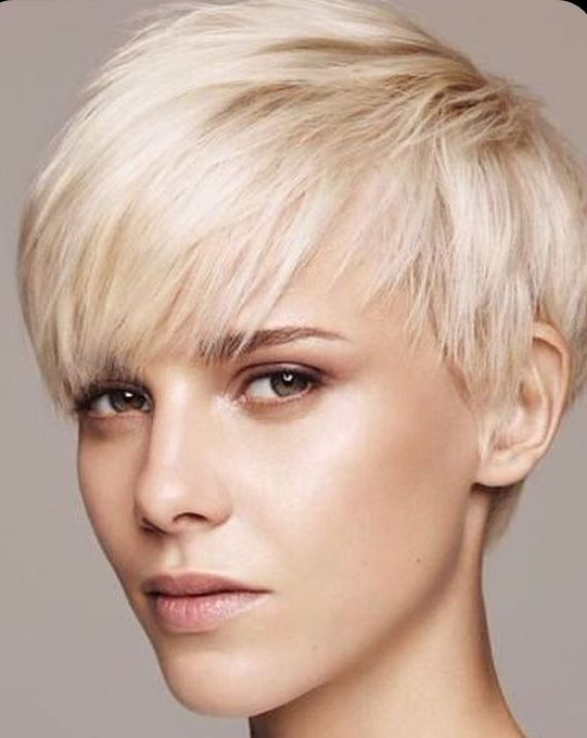 Round face pixie cut with bangs
