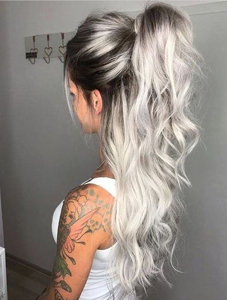 Short silver hair with dark roots
